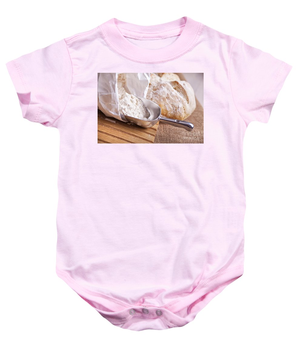 Canvas Baby Onesie featuring the photograph Scoop Of Flour And Fresh Bread by Sophie McAulay