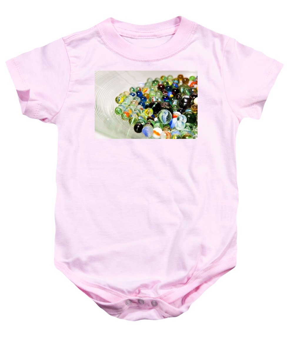 Abstract Baby Onesie featuring the photograph Stack Of Marbles by Tim Hester