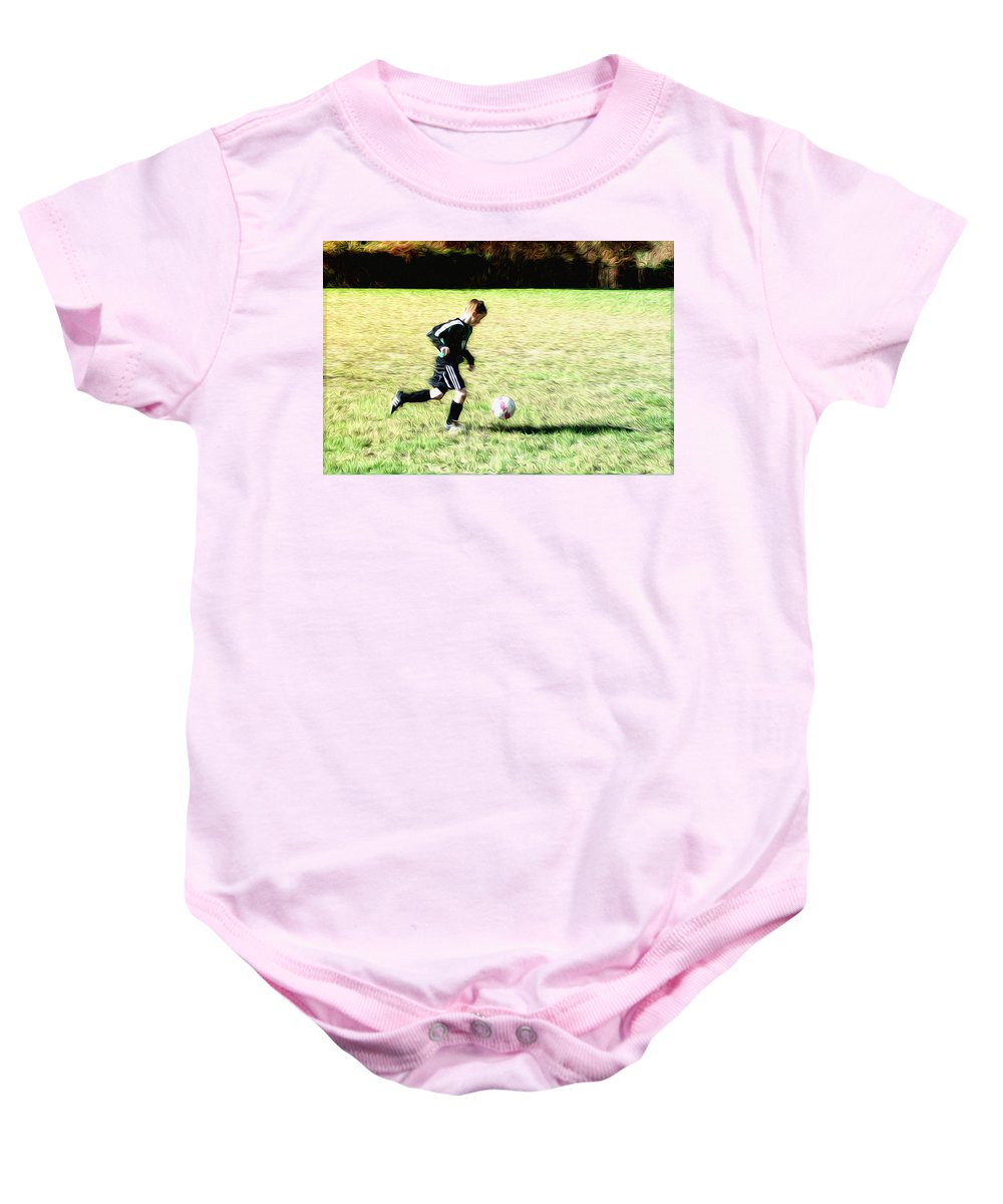 Footballer Baby Onesie featuring the photograph Footballer by Bill Cannon