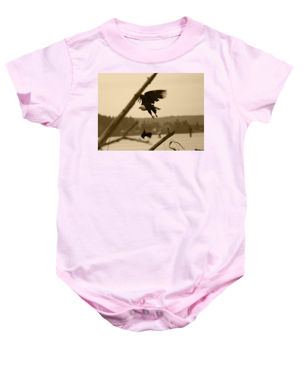 Bald Eagle Baby Onesie featuring the photograph The Eagle Flies With The Crow by Kym Backland