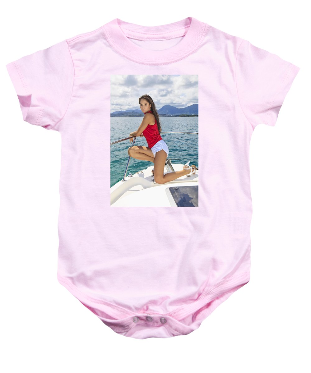 Attractive Baby Onesie featuring the photograph Woman Boating At Kaneohe by Tomas del Amo - Printscapes