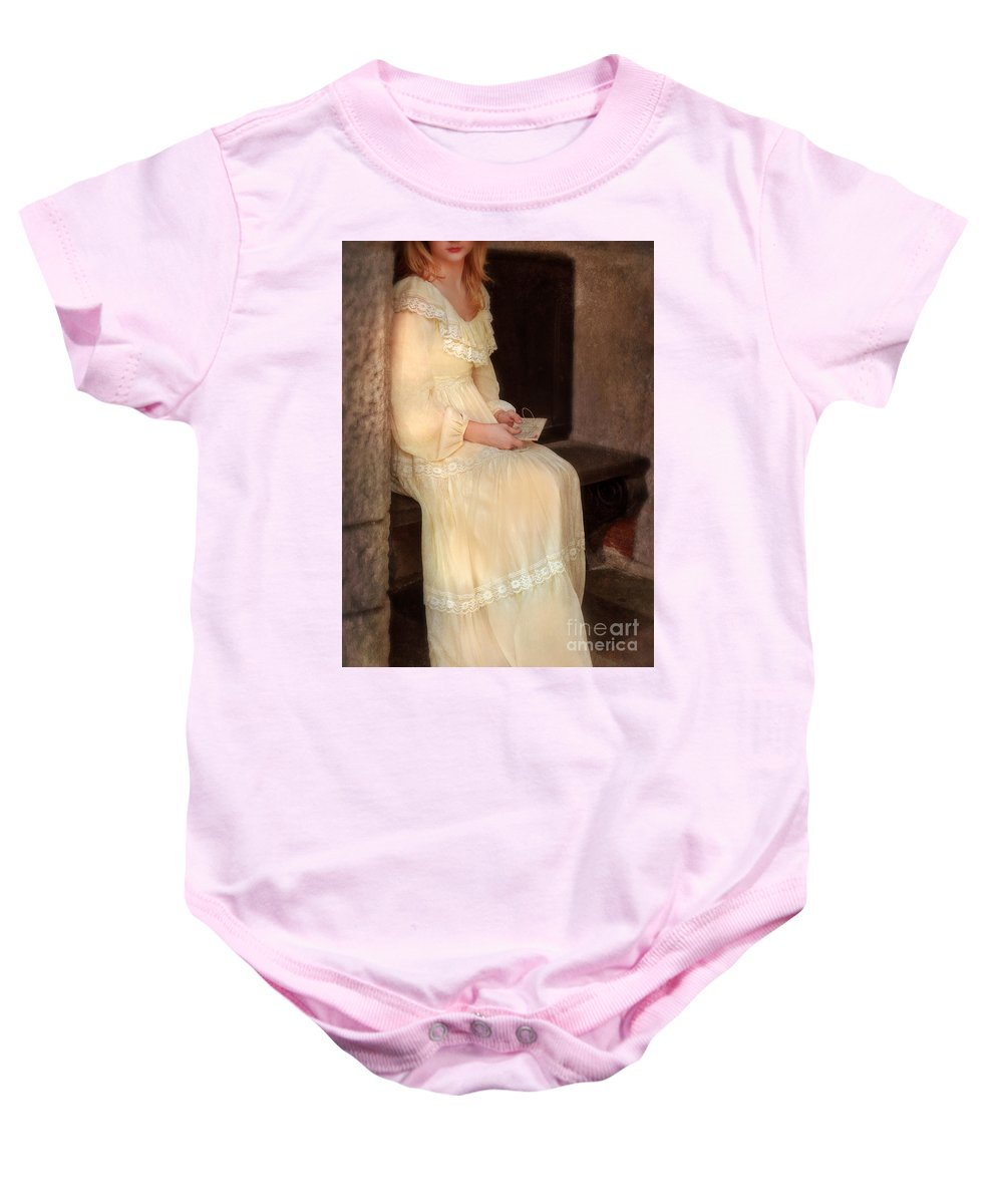 Lady Baby Onesie featuring the photograph Young Lady In Yellow Gown With Letters by Jill Battaglia