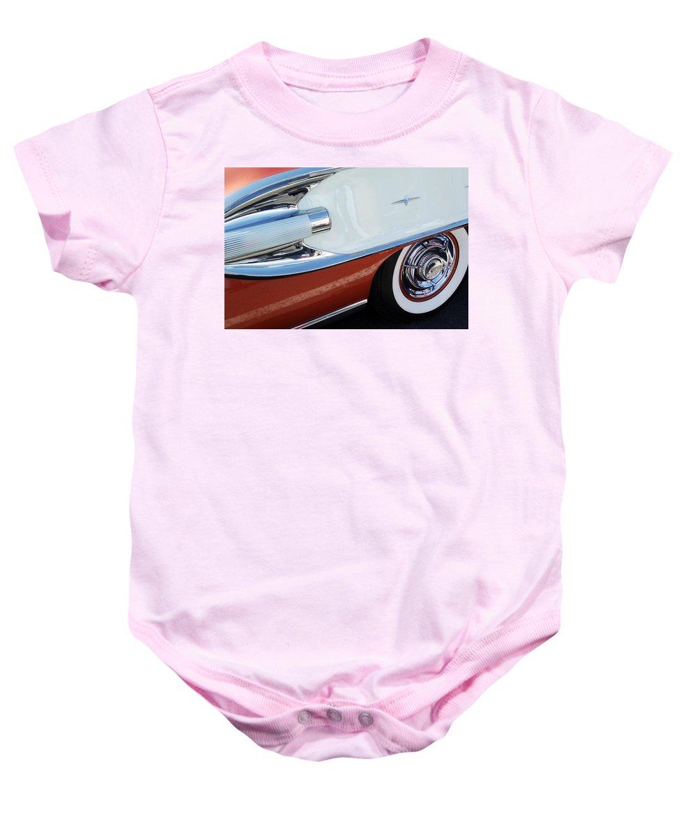 Car Baby Onesie featuring the photograph 1958 Pontiac Bonneville Wheel by Jill Reger