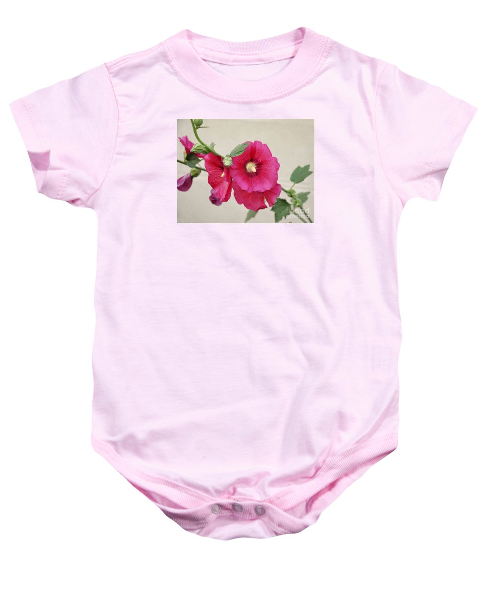 Flowers Baby Onesie featuring the photograph A Gentle Bloom by Reb Frost