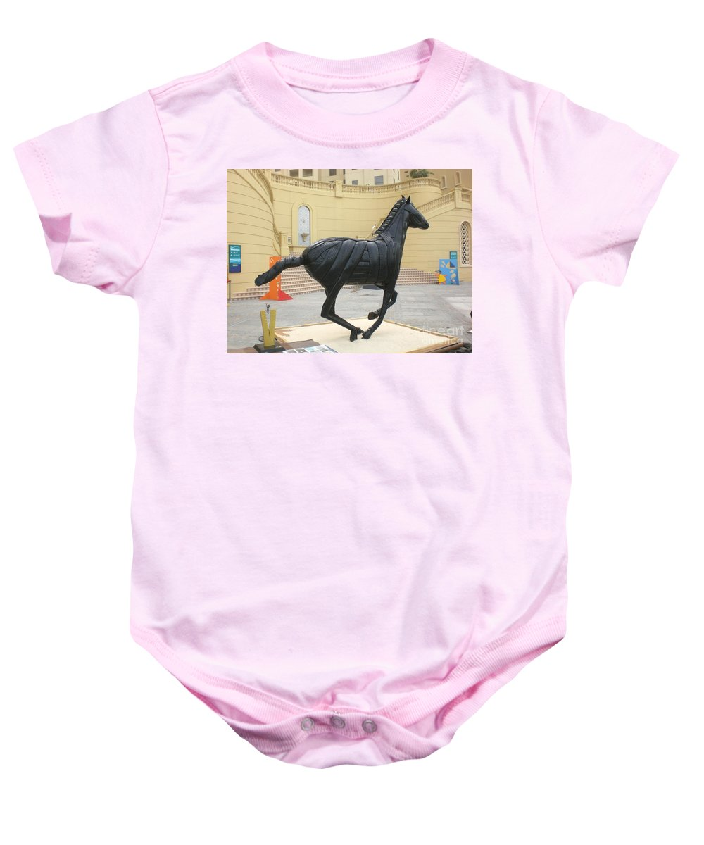 Horse Baby Onesie featuring the sculpture Black Stalion Tyre Sculpture by Mo Siakkou-Flodin
