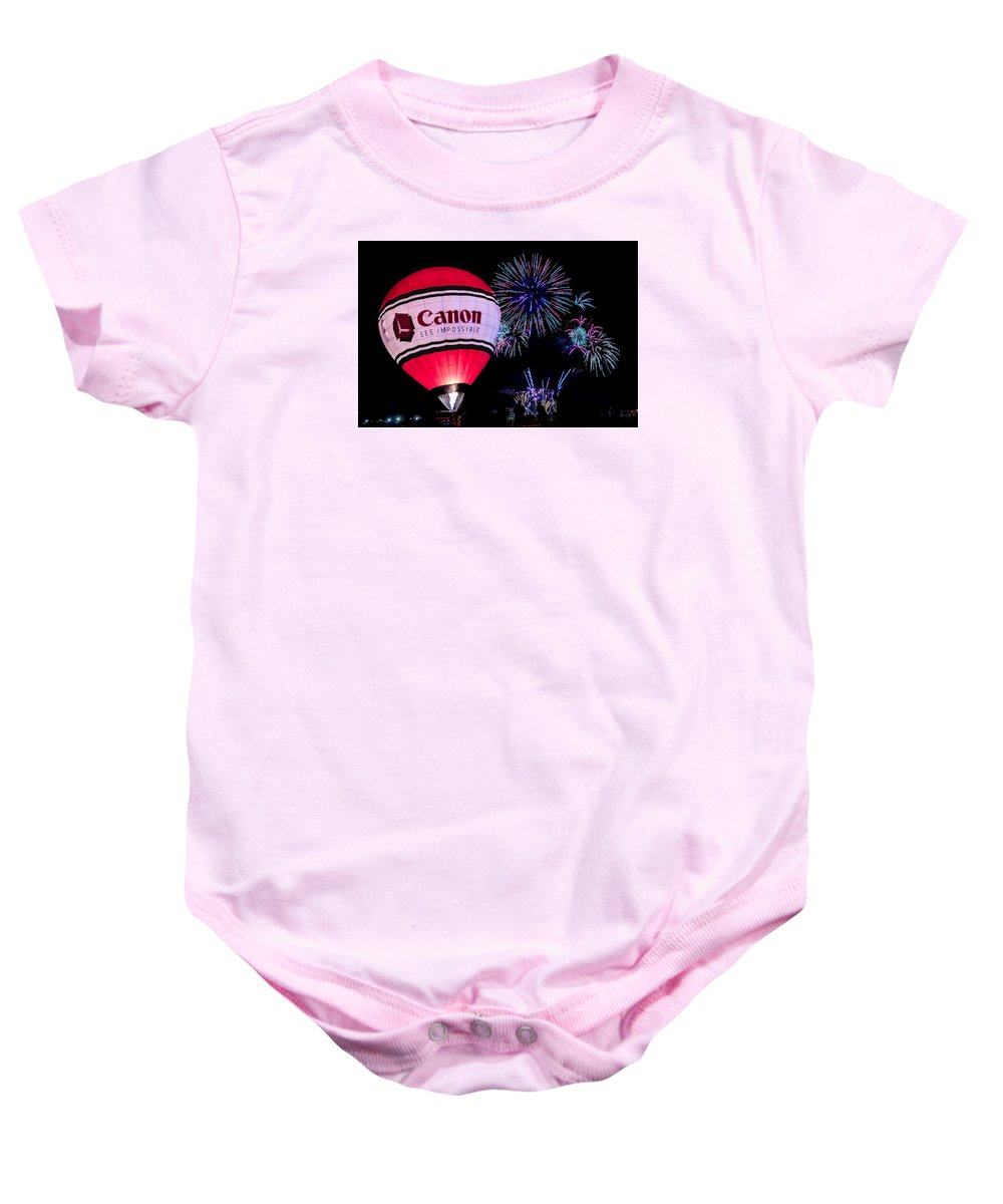 Albuquerque Baby Onesie featuring the photograph Canon - See Impossible - Hot Air Balloon With Fireworks by Ron Pate
