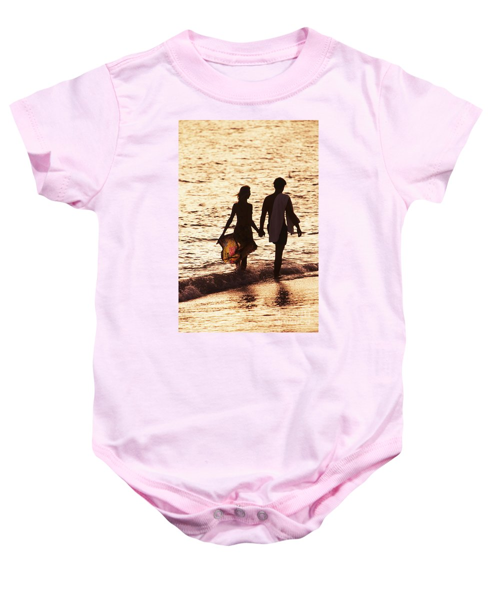Ashore Baby Onesie featuring the photograph Couple Wading In Ocean by Larry Dale Gordon - Printscapes