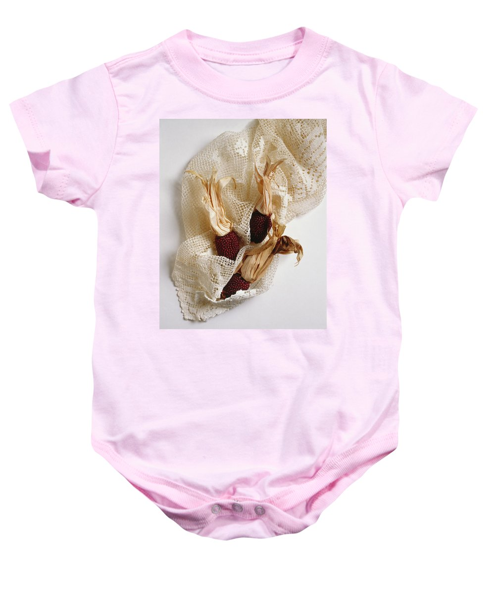 Composition Baby Onesie featuring the photograph Red Corn On The Cob And Lace by Stefania Levi