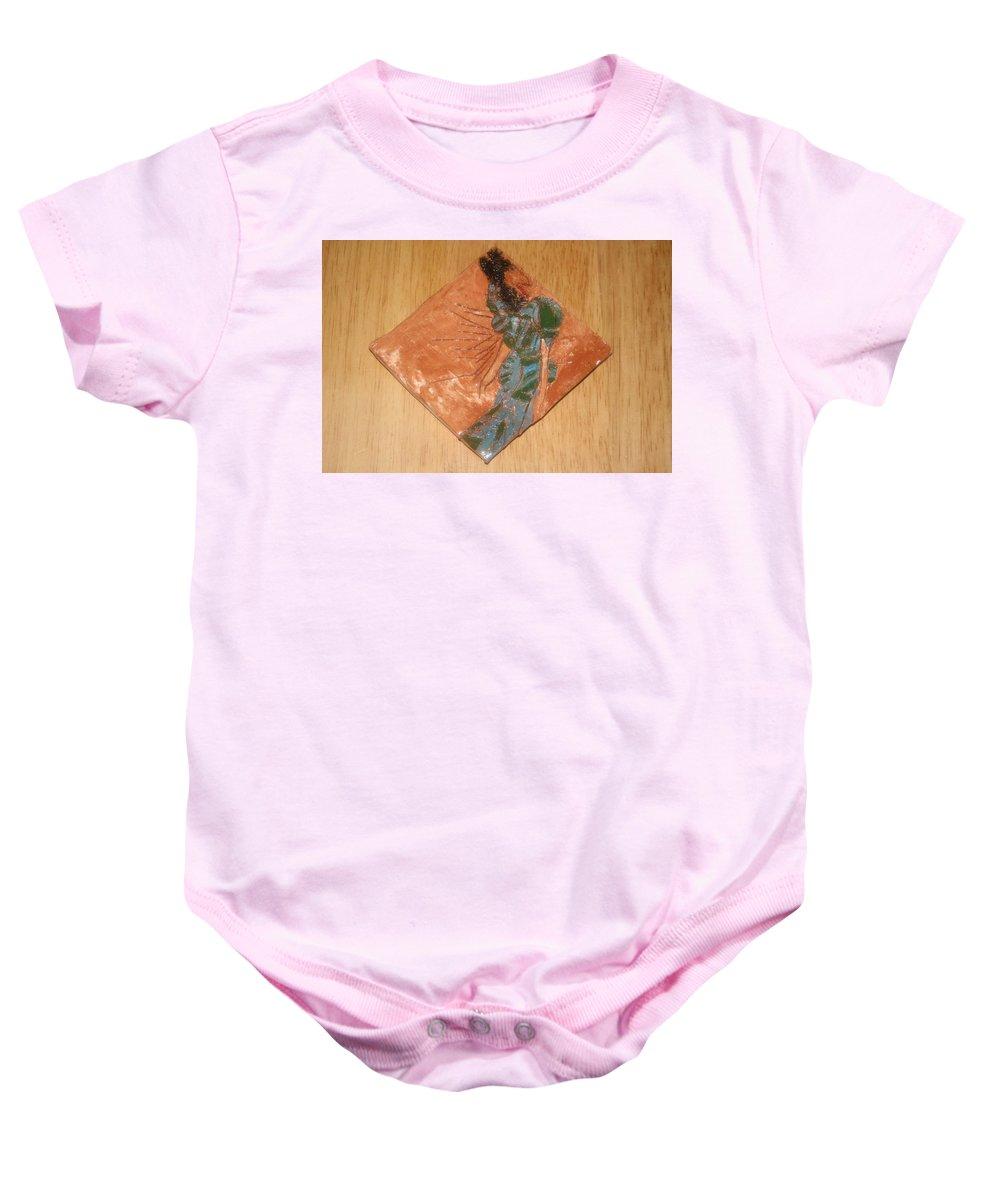 Jesus Baby Onesie featuring the ceramic art Roberta - Tile by Gloria Ssali