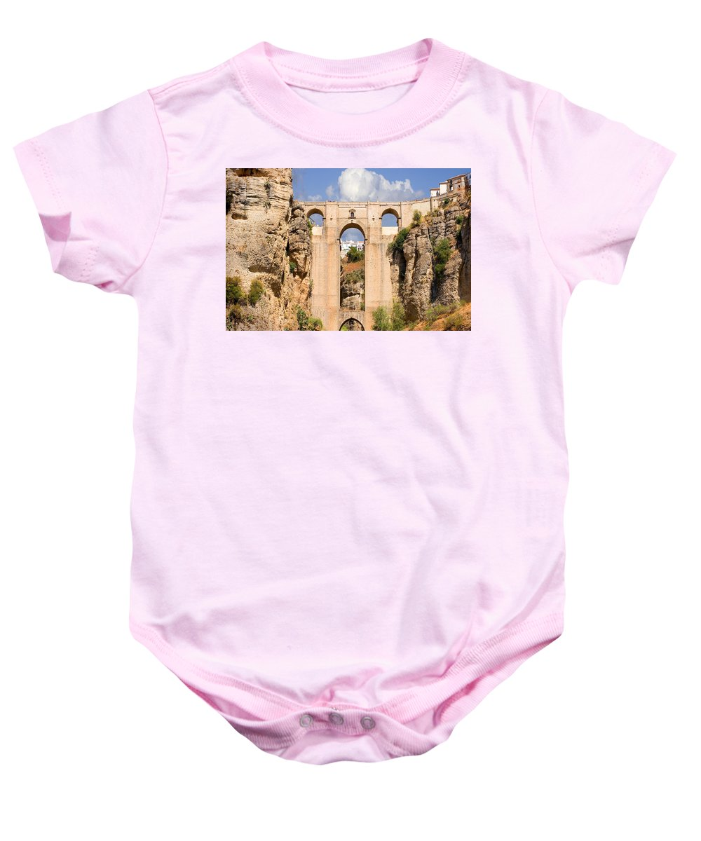 Ronda Baby Onesie featuring the photograph View Of The Tajo De Ronda And The Puente Nuevo Bridge From Across The Valley by Mal Bray