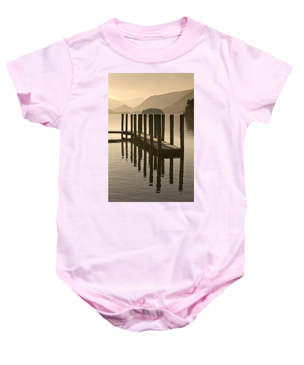 Calm Baby Onesie featuring the photograph Wooden Dock In The Lake At Sunset by John Short