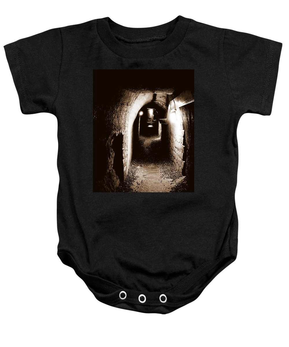Paris Baby Onesie featuring the photograph A Tunnel In The Catacombs Of Paris France by Richard Rosenshein