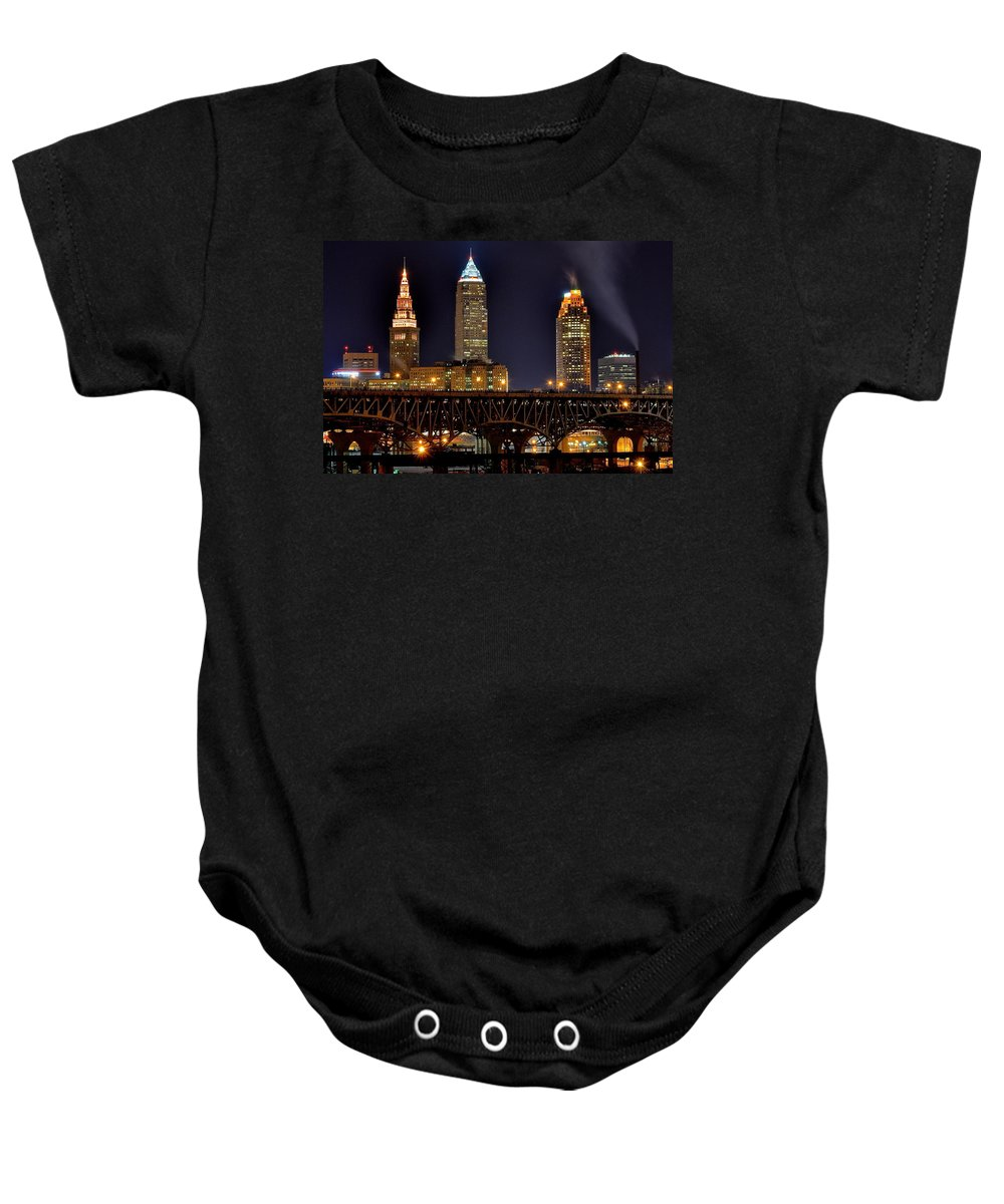 Cleveland Baby Onesie featuring the photograph Cleveland Skyline At Night by Frozen in Time Fine Art Photography
