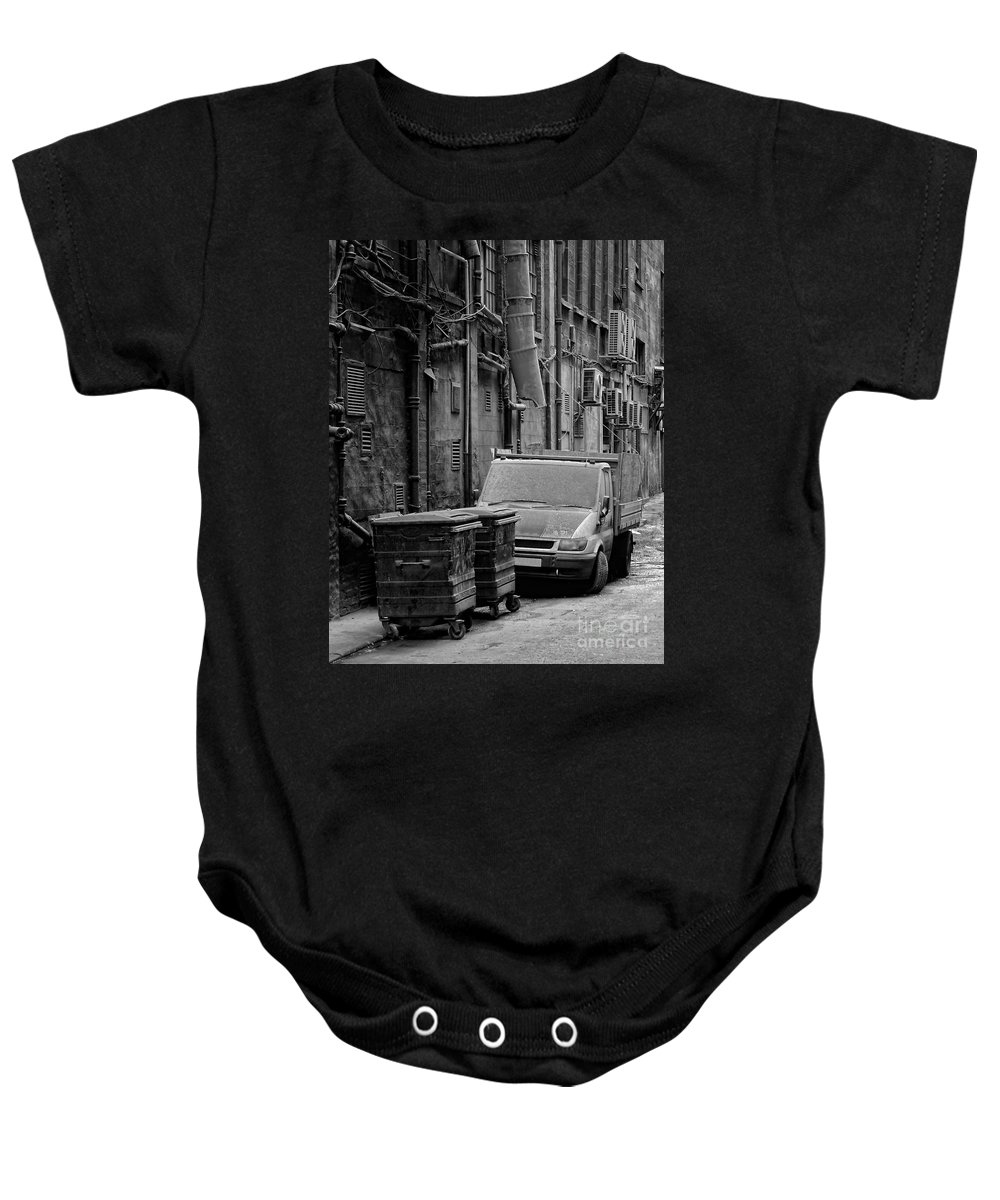 Black Baby Onesie featuring the photograph Dirty Back Streets Mono by Antony McAulay