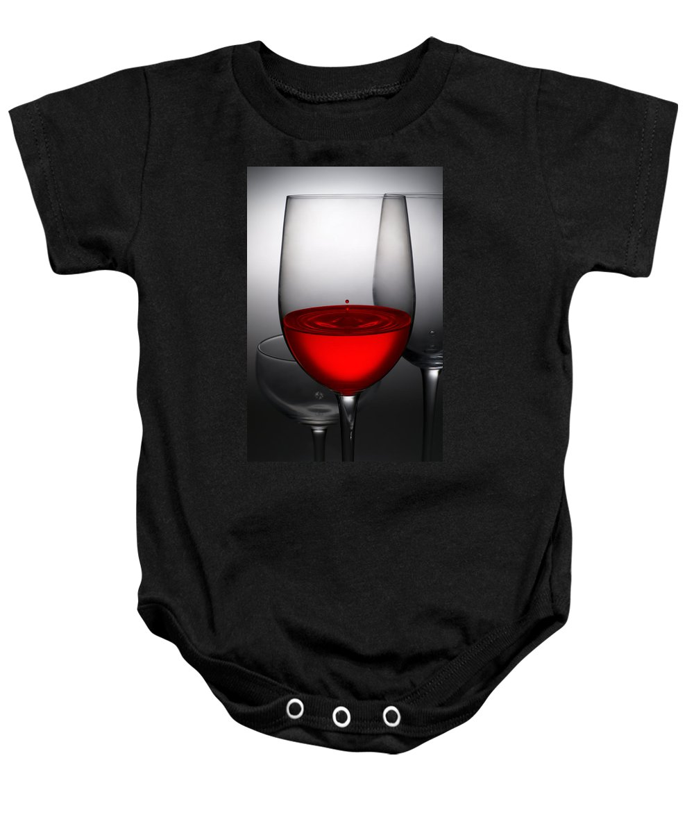 Abstract Baby Onesie featuring the photograph Drops Of Wine In Wine Glasses by Setsiri Silapasuwanchai