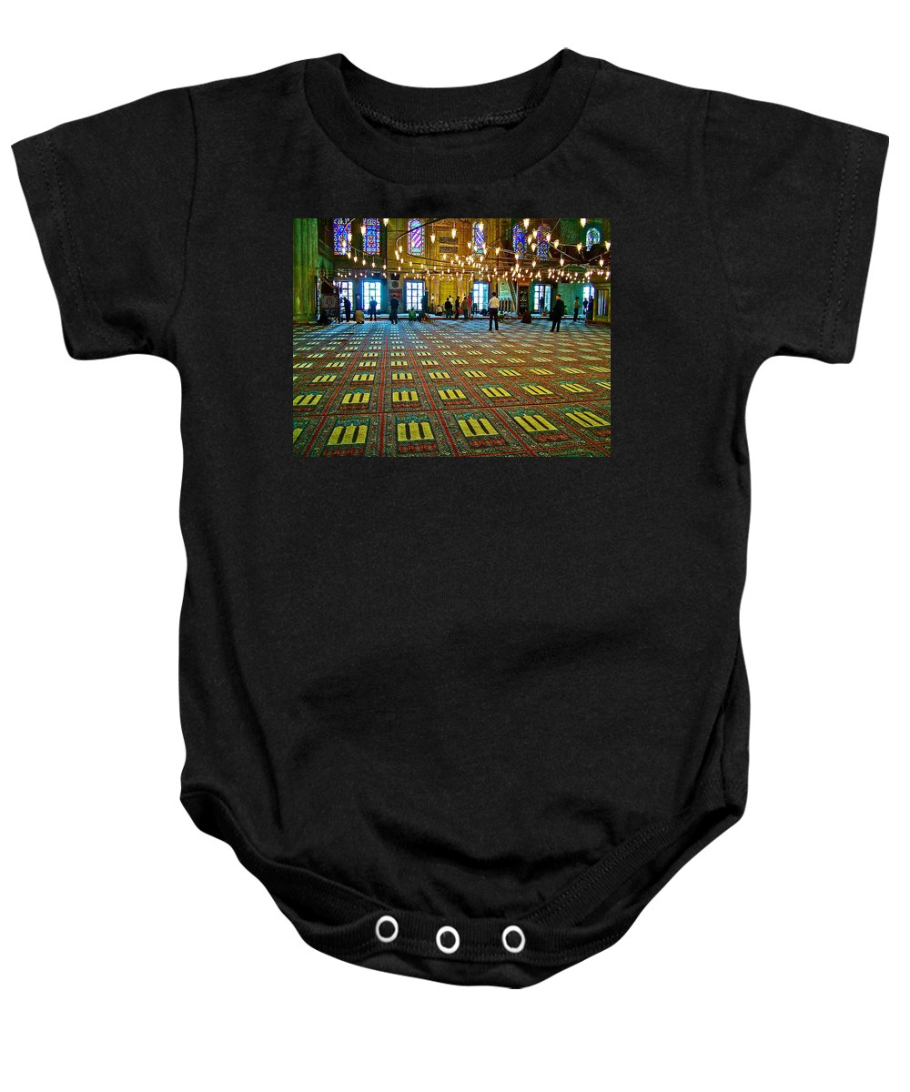 Men Inside The Blue Mosque In Istanbul Baby Onesie featuring the photograph Men Inside The Blue Mosque In Istanbul-turkey by Ruth Hager