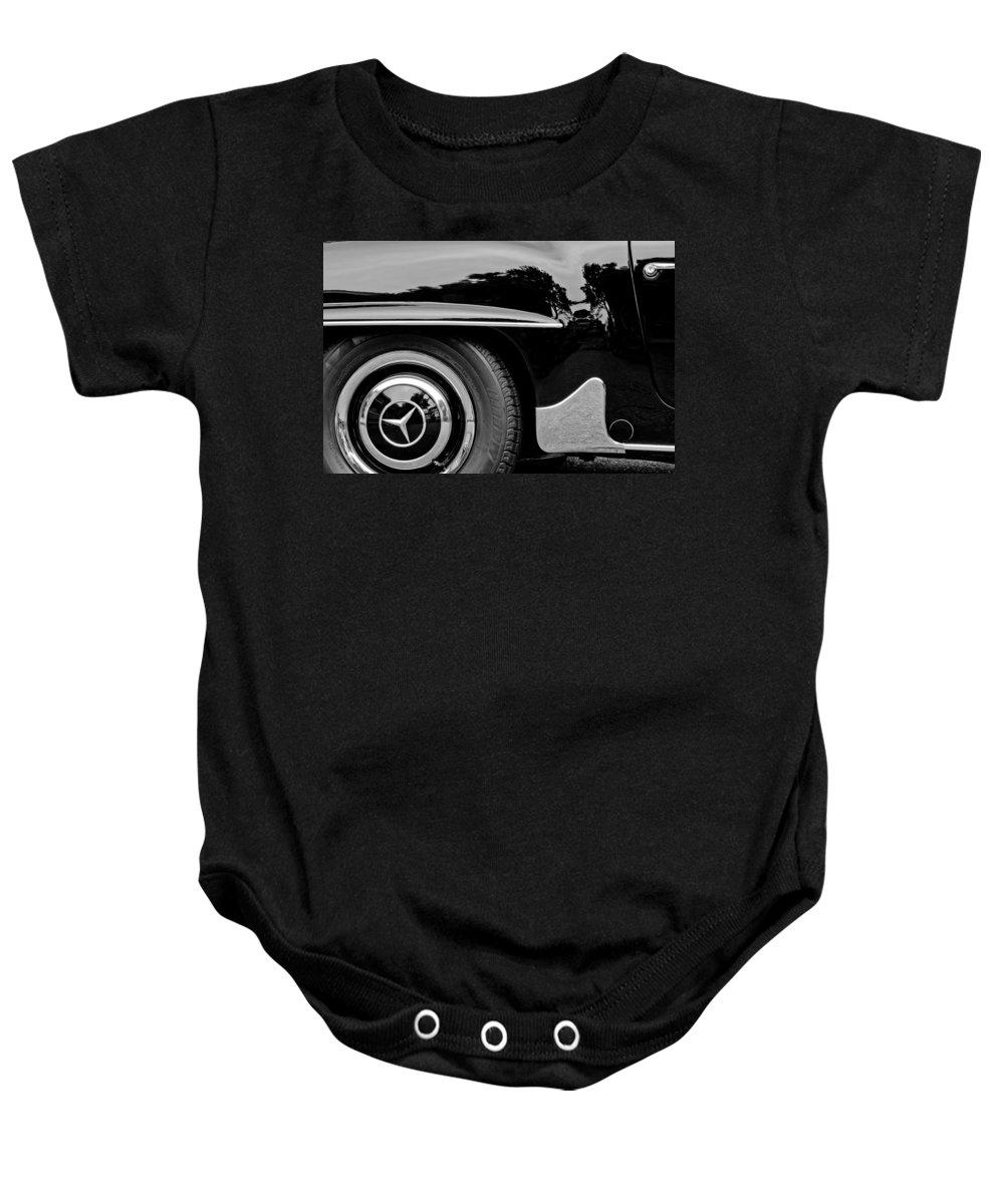 Mercedes-benz Wheel Emblem Baby Onesie featuring the photograph Mercedes-benz Wheel Emblem by Jill Reger