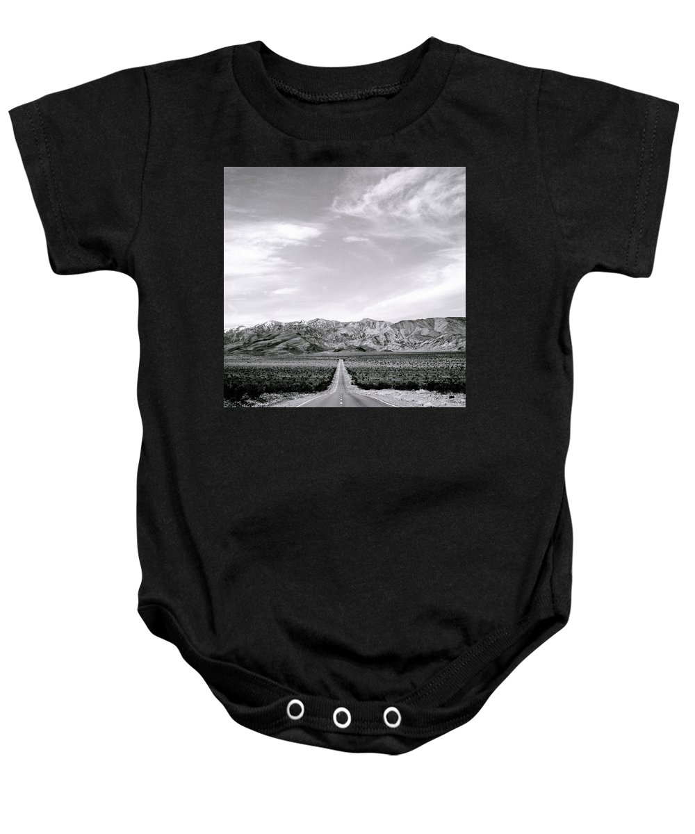 Inspiration Baby Onesie featuring the photograph On The Road by Shaun Higson