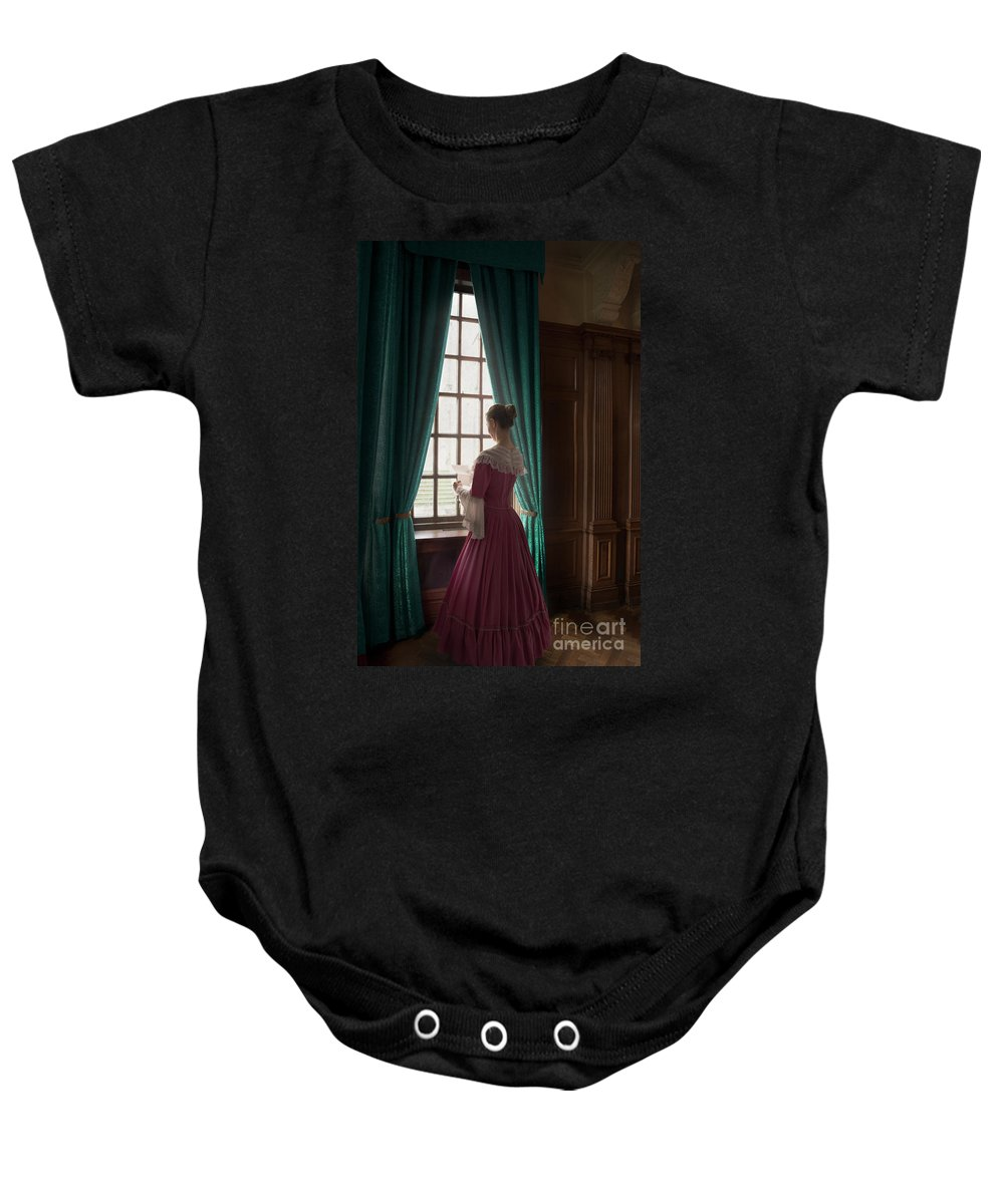 Woman Baby Onesie featuring the photograph Woman In Georgian Period Dress Reading A Letter By The Window by Lee Avison