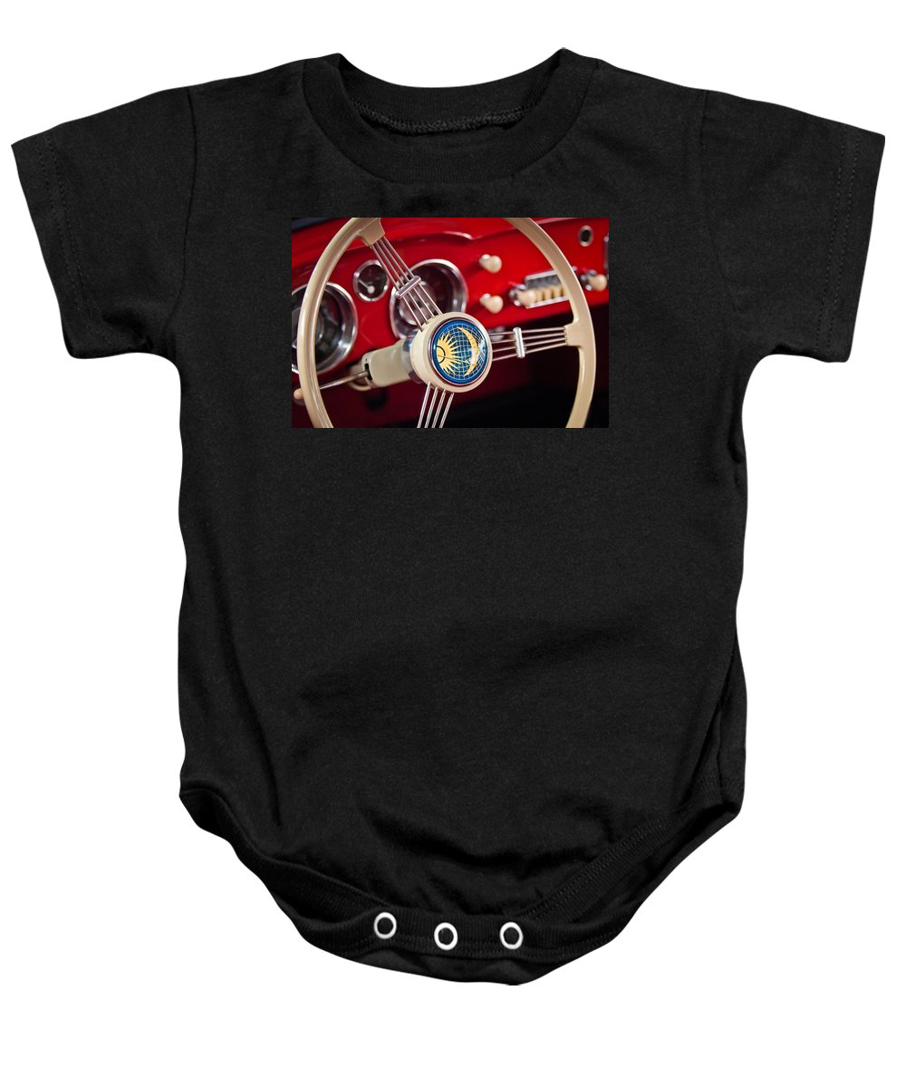 1956 Volkswagen Karmann Ghia Coupe Steering Wheel Emblem Baby Onesie featuring the photograph 1956 Volkswagen Vw Karmann Ghia Coupe Steering Wheel 2 by Jill Reger