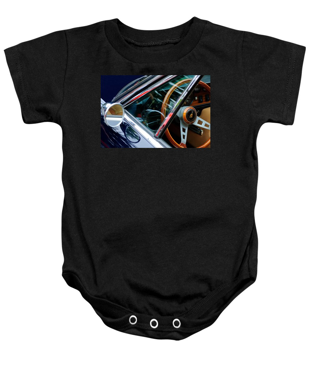 1969 Lamborghini Islero Steering Wheel Emblem Baby Onesie featuring the photograph 1969 Lamborghini Islero Steering Wheel Emblem by Jill Reger