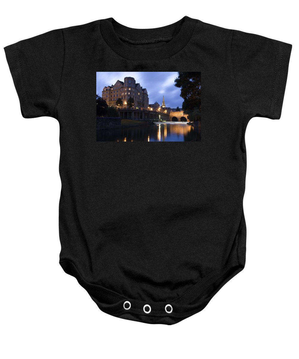 Bath Baby Onesie featuring the photograph Bath City Spa Viewed Over The River Avon At Night by Mal Bray
