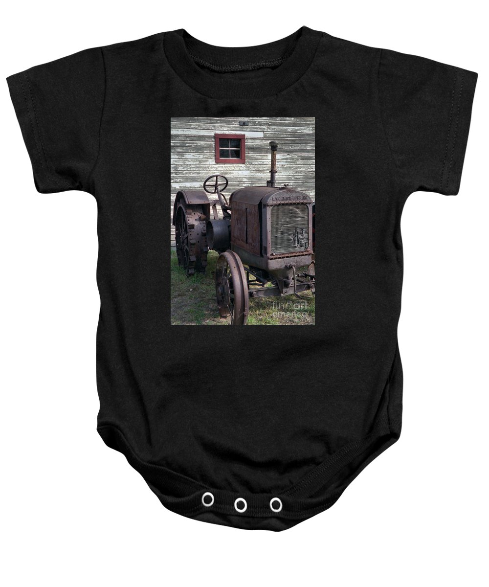 Farm Tractor Baby Onesie featuring the photograph The Old Mule by Richard Rizzo