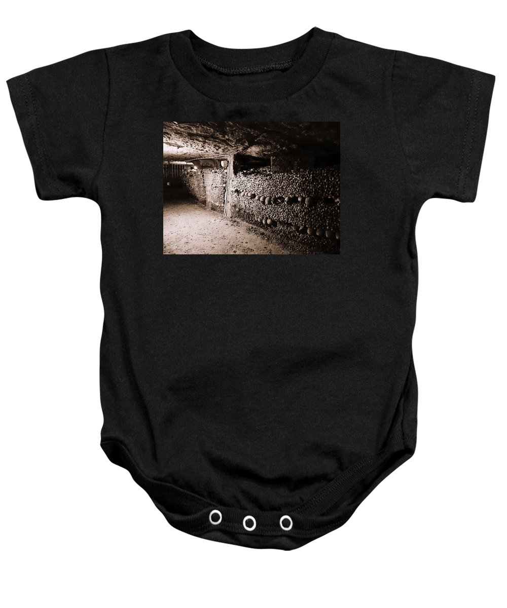 Paris Baby Onesie featuring the photograph Skulls And Bones In The Catacombs Of Paris France by Richard Rosenshein