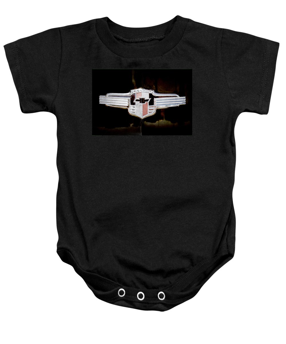 1942 Chevrolet Emblem Baby Onesie featuring the photograph 1942 Chevrolet Emblem by Jill Reger