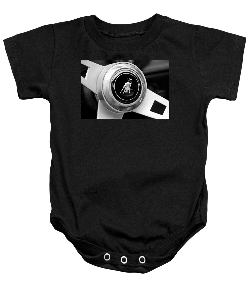 Lamborghini Steering Wheel Emblem Baby Onesie featuring the photograph Lamborghini Steering Wheel Emblem by Jill Reger