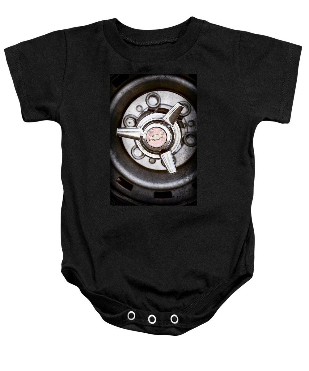 Chevrolet Wheel Emblem Baby Onesie featuring the photograph Chevrolet Wheel Emblem by Jill Reger
