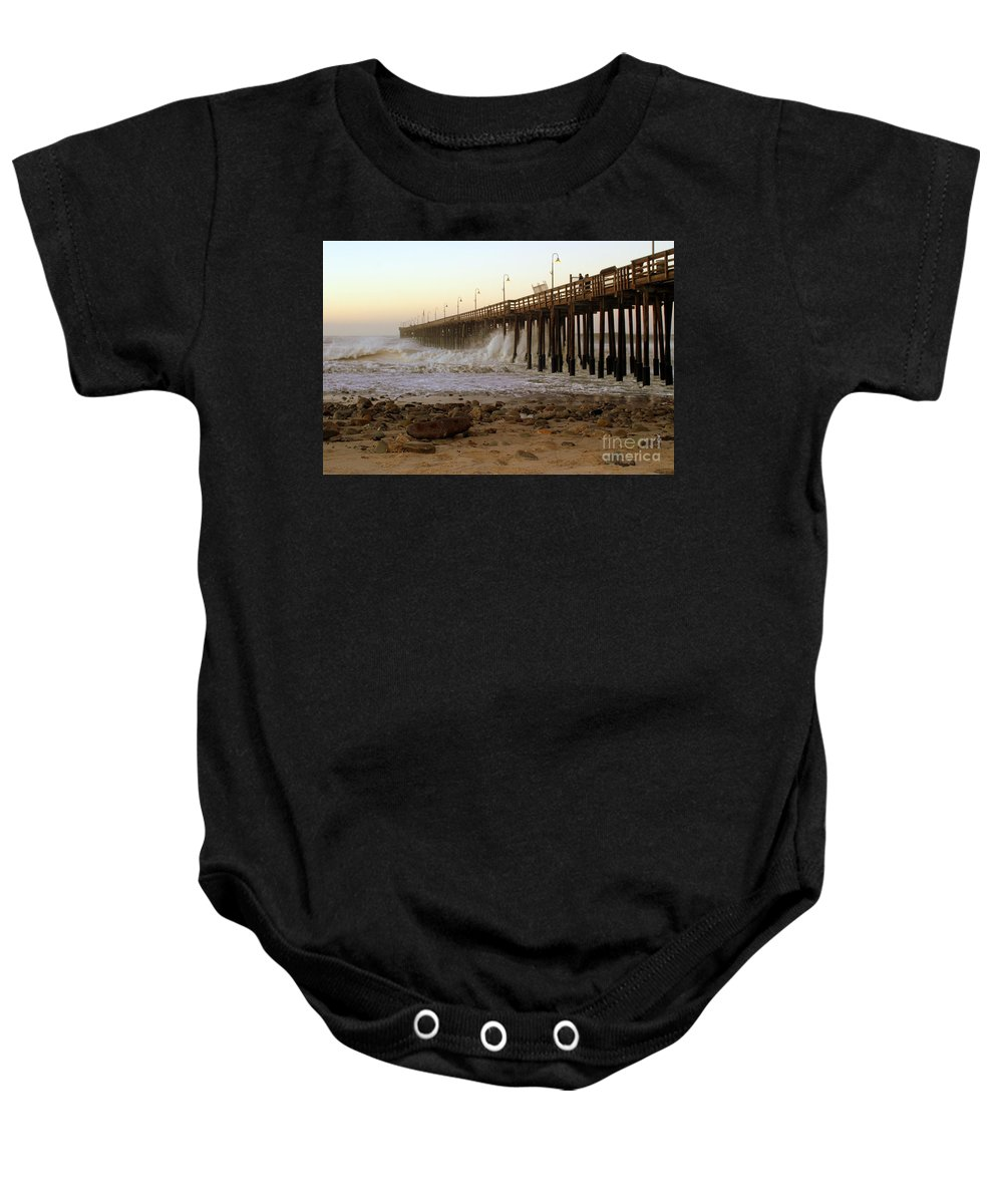 Sunrise Baby Onesie featuring the photograph Ocean Wave Storm Pier by Henrik Lehnerer