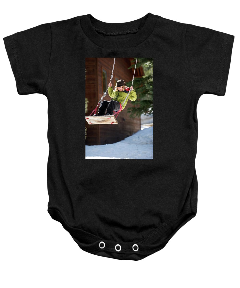 10-11 Years Baby Onesie featuring the photograph A Boy Plays Outside In Lake Tahoe by Corey Rich