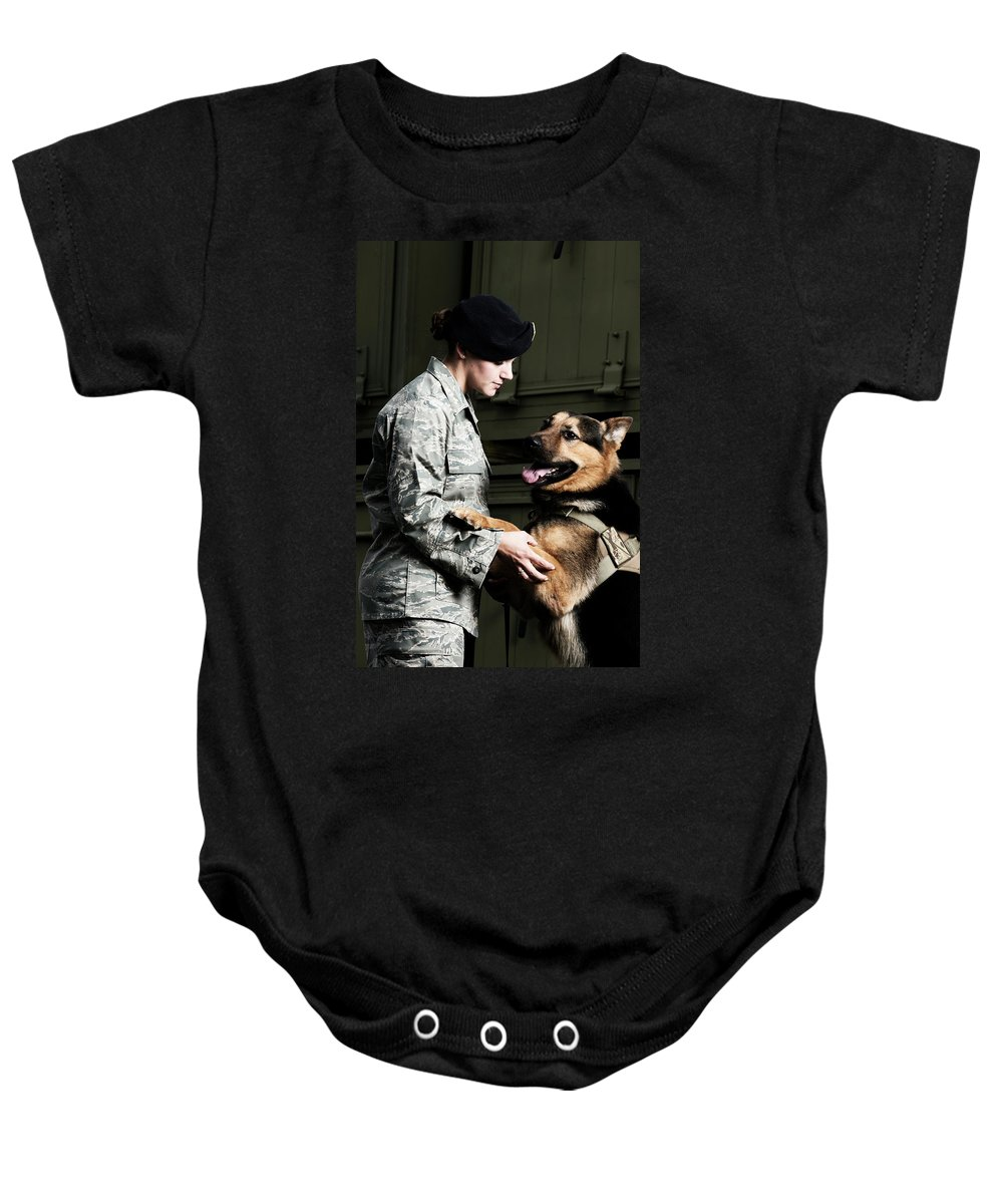 Airplane Hangar Baby Onesie featuring the photograph A Caucasian, Female Air Force Security by Stacy Pearsall