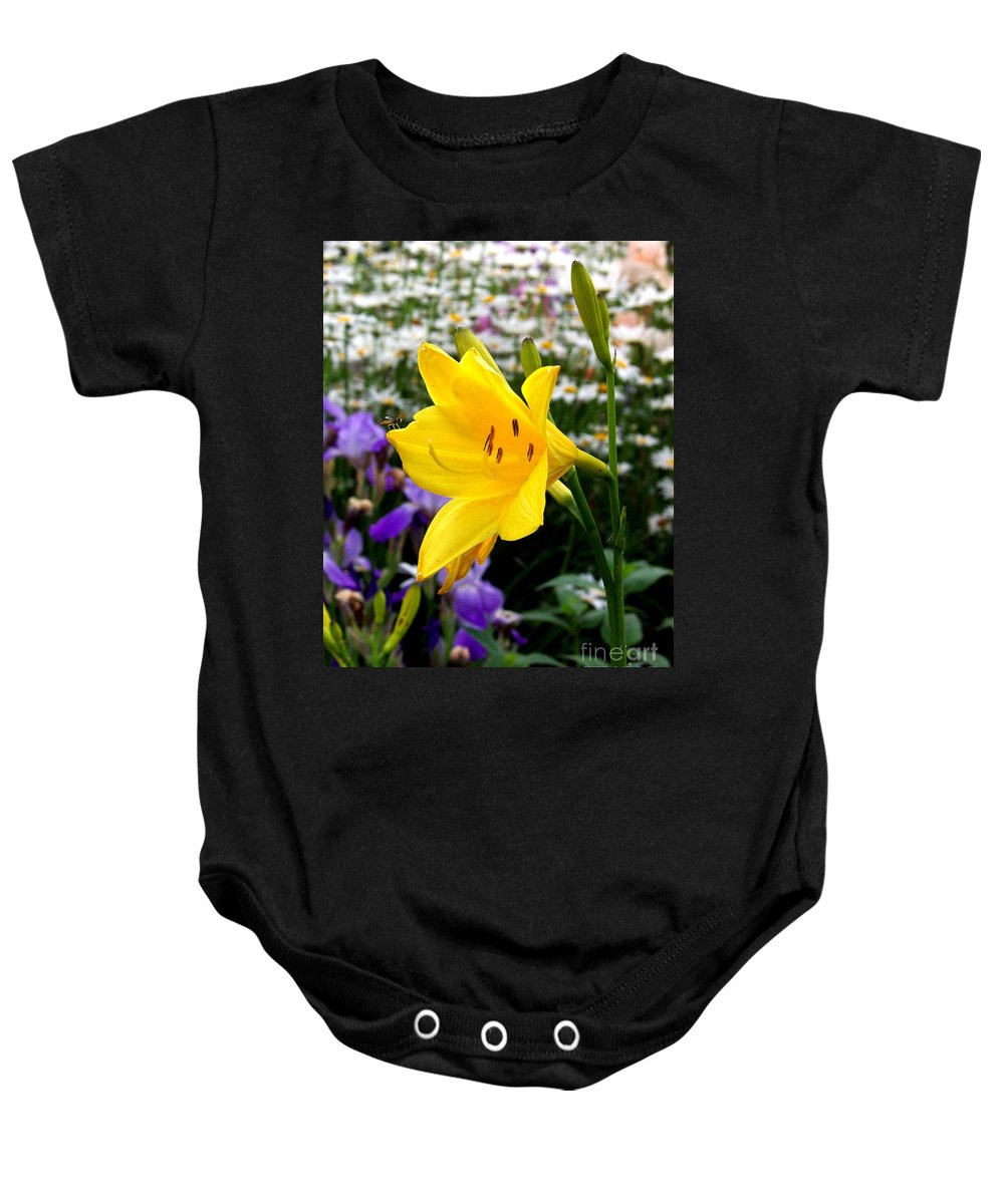 Lily Baby Onesie featuring the photograph A Fly In The Ointment by Kathy McClure