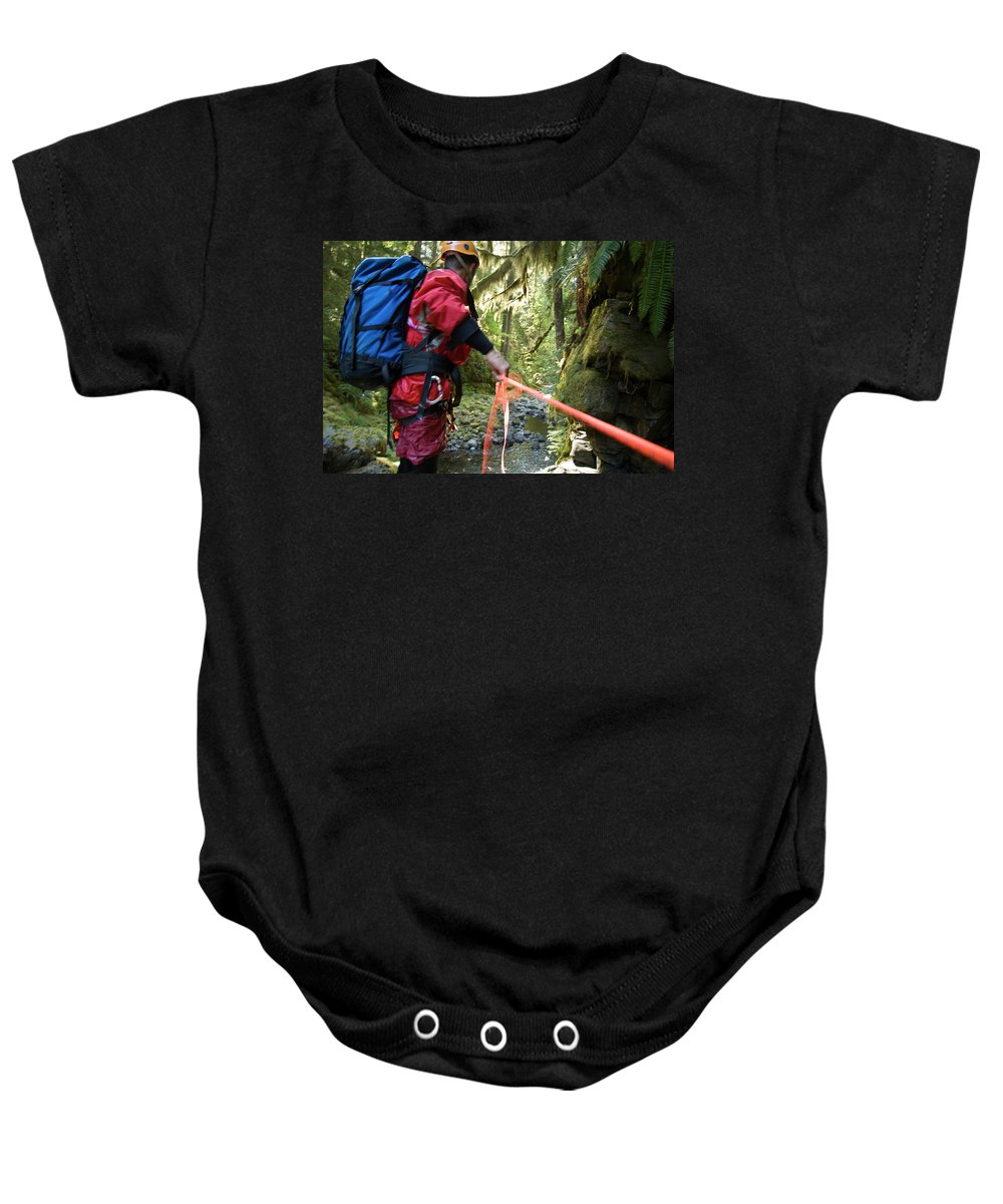 Abseil Baby Onesie featuring the photograph A Man Lowers A Rope For Canyoning by Frank Huster