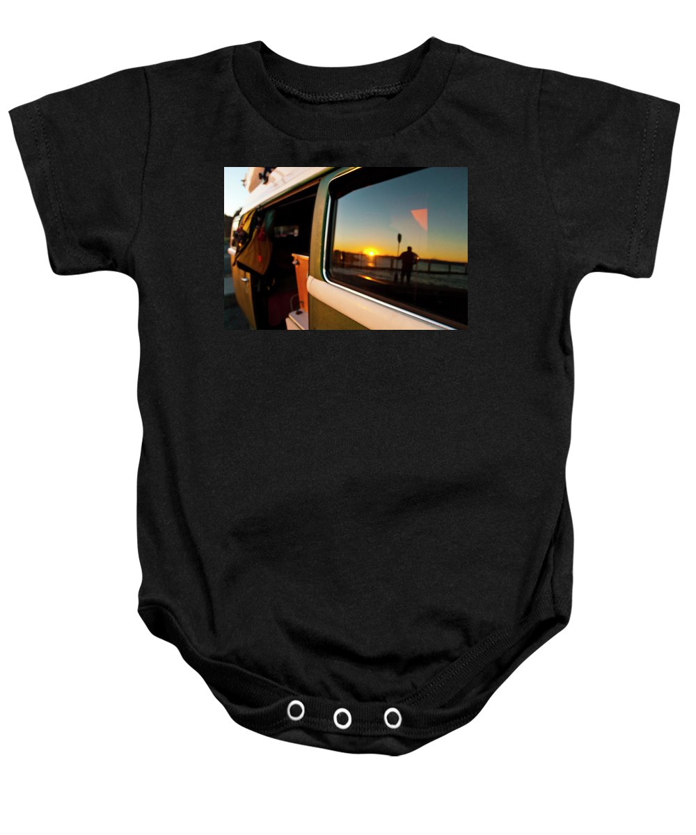 35-39 Years Baby Onesie featuring the photograph A Silhouette Of A Man Holding A Paddle by Steve MacAulay