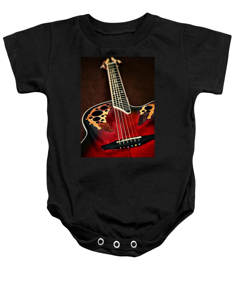 Guitar Baby Onesie featuring the photograph Acoustical Red by Karol Livote