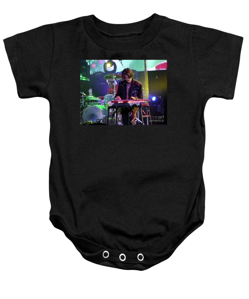 Aerosmith Baby Onesie featuring the photograph Aerosmith-joe Perry-00124 by Gary Gingrich Galleries