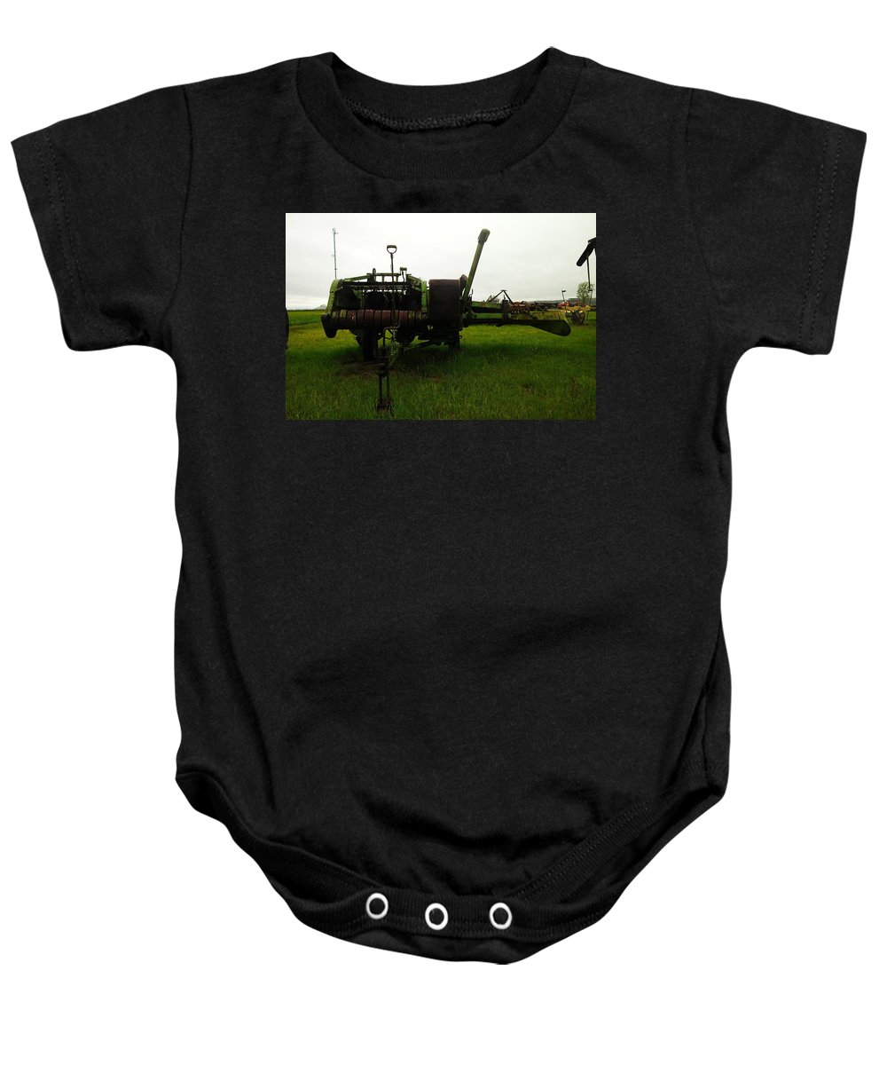 Farm Equipment Baby Onesie featuring the photograph An Old Bailor by Jeff Swan