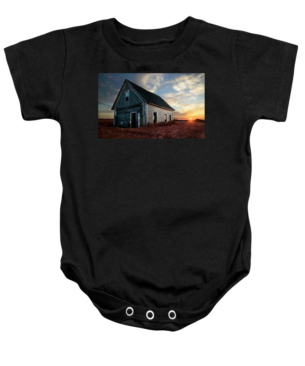 Abandoned Baby Onesie featuring the photograph An Old Farm House Sits Partially Buried by Robert van Waarden