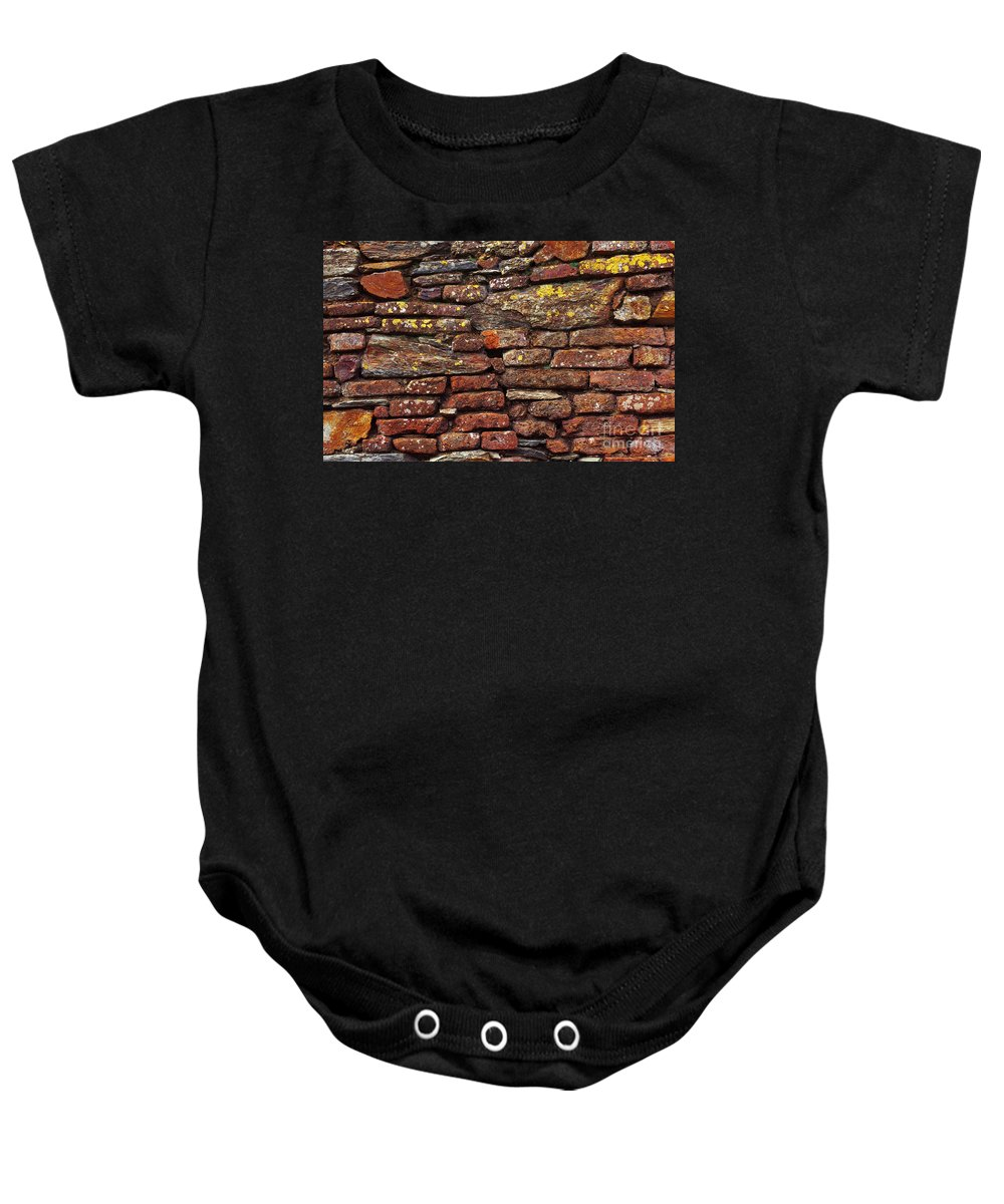 Aged Baby Onesie featuring the photograph Ancient Wall by Carlos Caetano