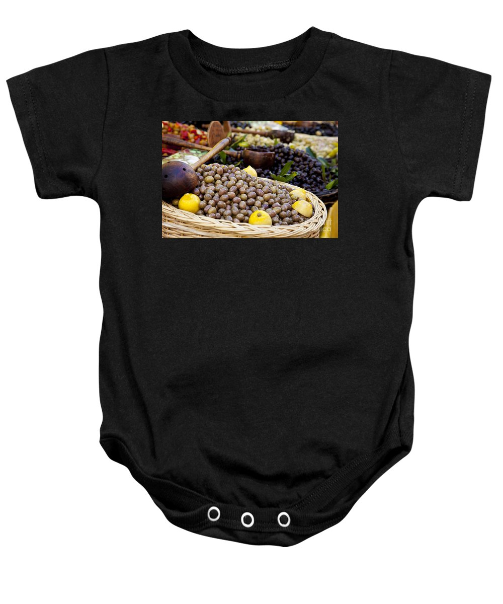 Olive Baby Onesie featuring the photograph At The Market by Brian Jannsen