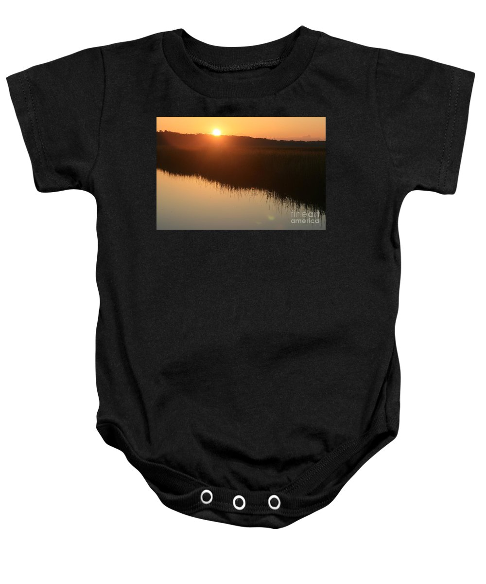 Sunrise Baby Onesie featuring the photograph Autumn Sunrise Over The Marsh by Nadine Rippelmeyer