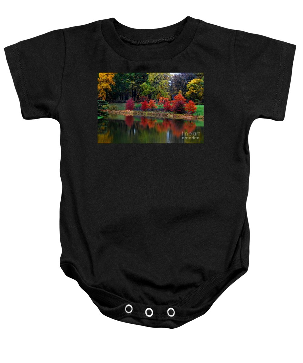Waterfall Baby Onesie featuring the photograph Autumn Trees Reflection by Nancy Mueller