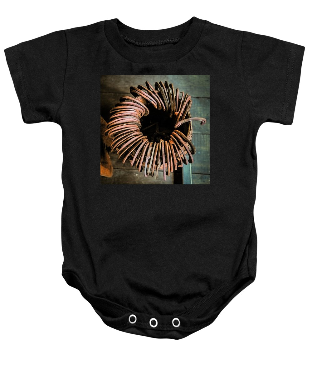 Horse Shoe Baby Onesie featuring the photograph Barrel Of Horseshoes by Paul Freidlund