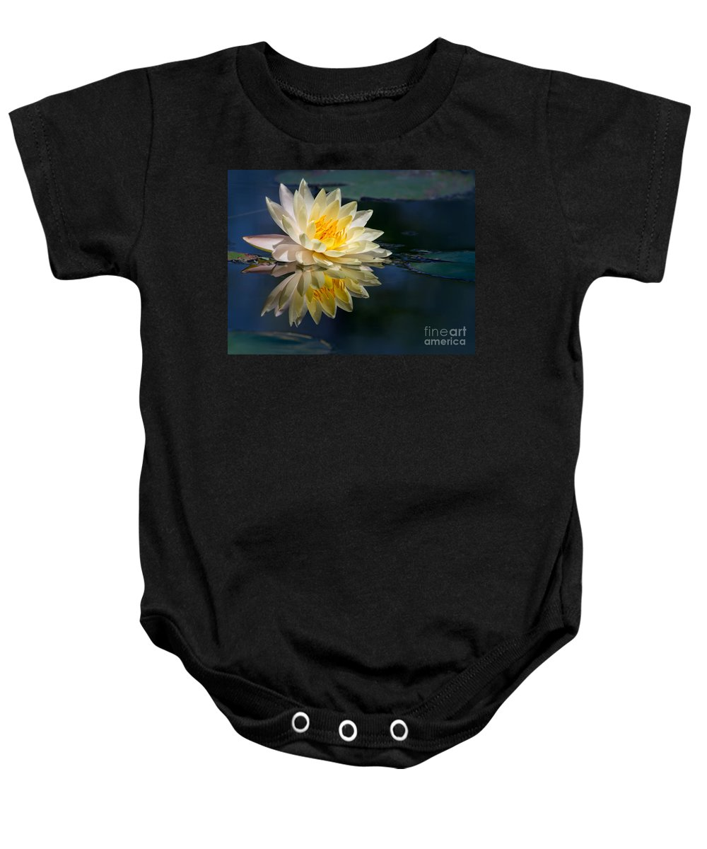 Landscape Baby Onesie featuring the photograph Beautiful Water Lily Reflection by Sabrina L Ryan