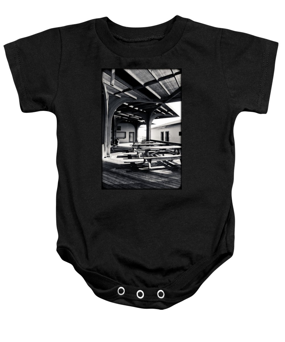 Corpus Christi Baby Onesie featuring the photograph Benches At The Beach by Eric Benjamin