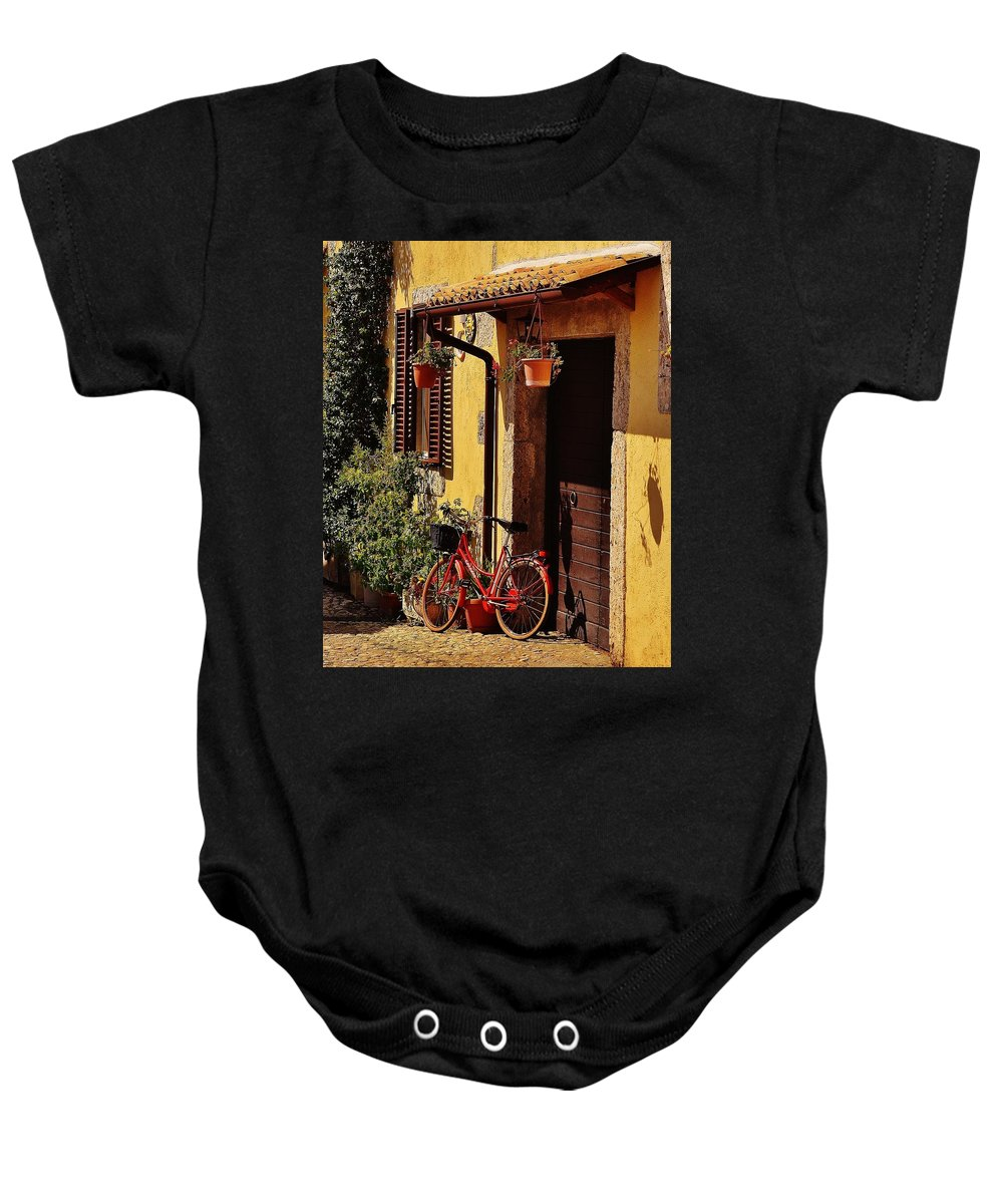 Street Baby Onesie featuring the photograph Bicycle Under The Porch by Dany Lison