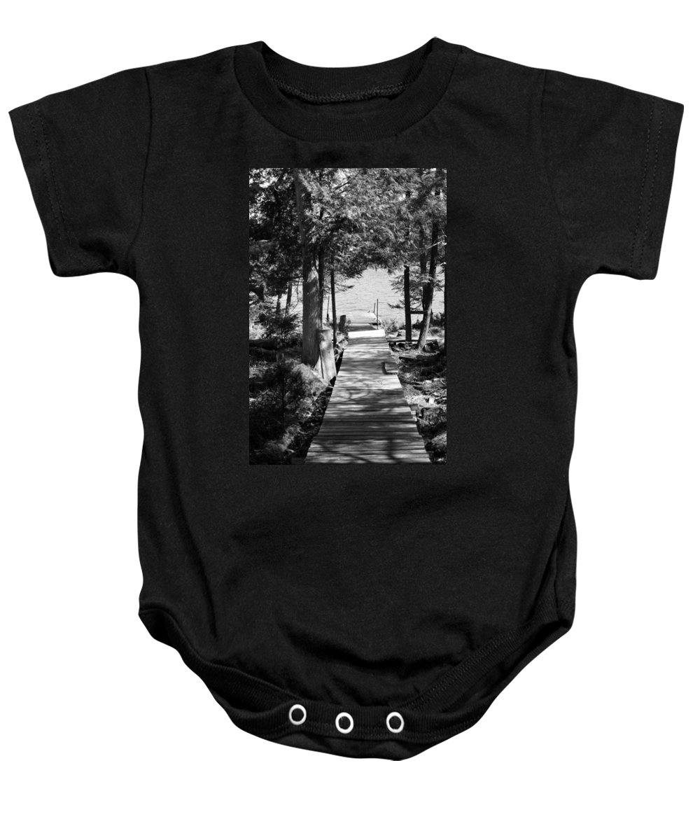 Walkway Baby Onesie featuring the photograph Black And White Walkway by Thomas Phillips
